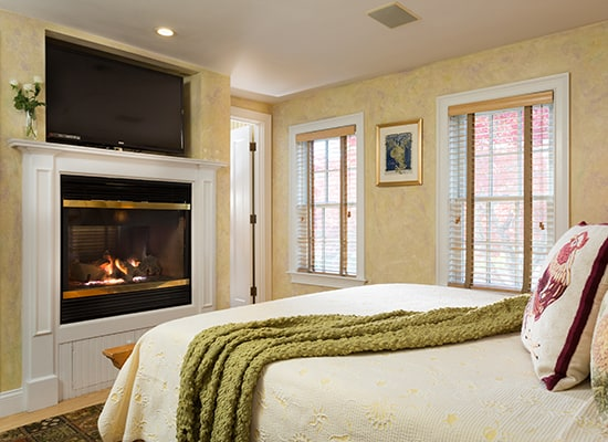 Cozy room with a fireplace at Provincetown, MA bed and breakfast