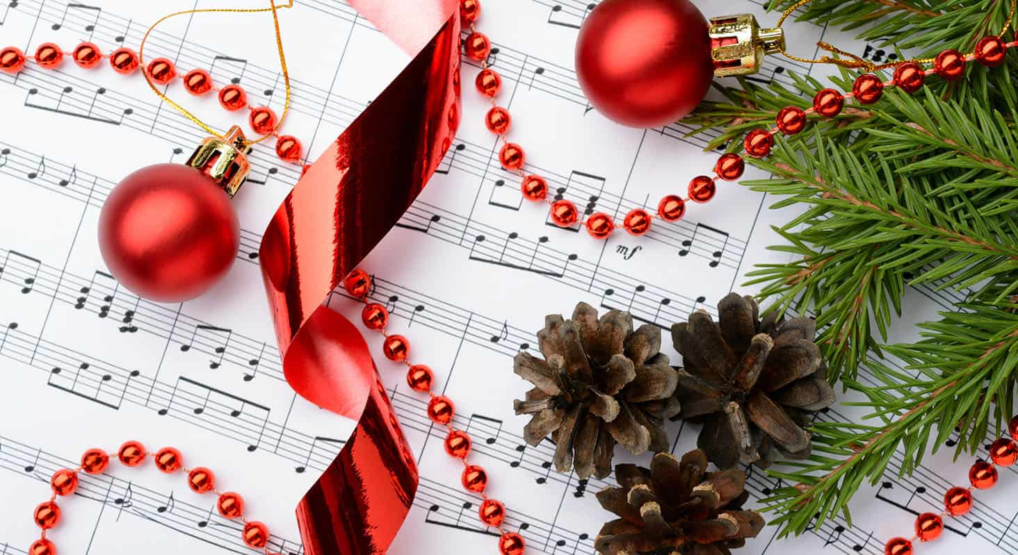 Christmas decorations on sheet music