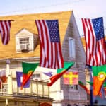 American flags flying above the buildings in Cape Cod Provincetown in Massachusetts USA