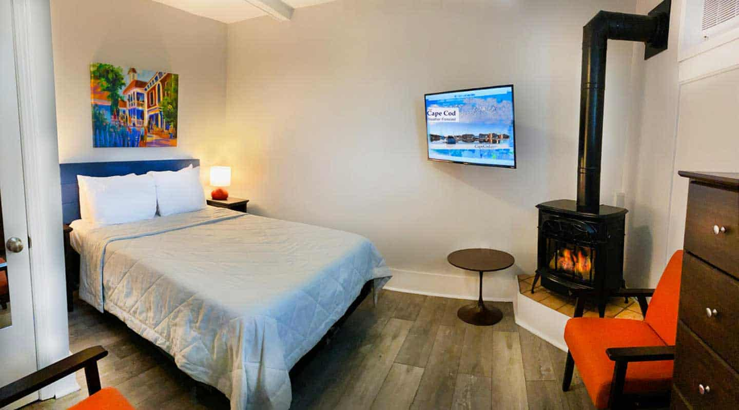 Myles bedroom with queen size bed and a fireplace